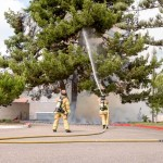 Encinitas firefighters spray water on a fire that appears to have originated on the grounds of the San Dieguito United Methodist Church on Calle Magdalena in Encinitas. Photo Bill Reilly