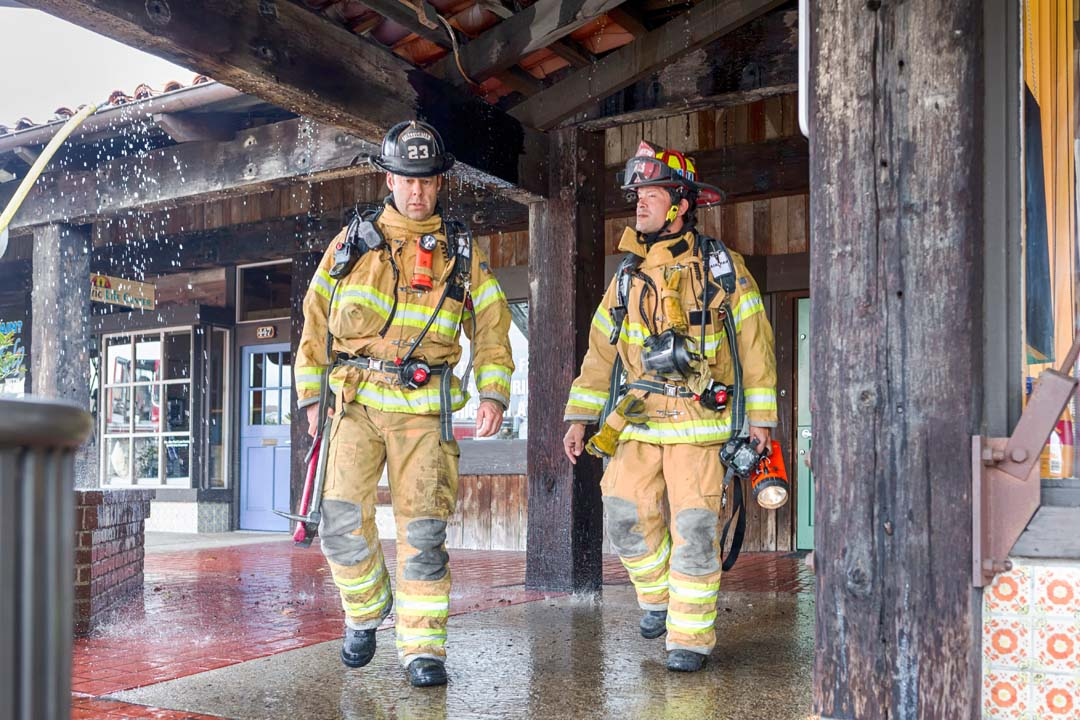 Encinitas firefighters assess the structure at 441 Encinitas Blvd. on Sunday shortly after 3:30 p.m. Photo by Bill Reilly