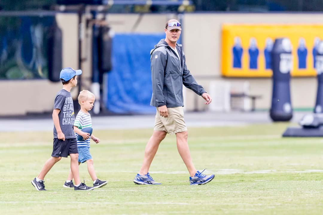 San Diego Chargers quarterback Philip Rivers walks across the field with his two sons during the 2016 rookie mini-camp held at Chargers Park. Photo by Bill Reilly