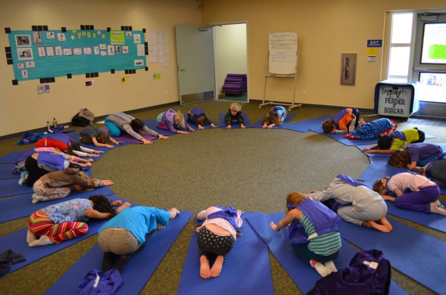 Students perform yoga at Paul Ecke Central. Encinitas school board officials tentatively agreed to use taxpayer dollars — to the tune of $800,000 next year — to keep it going. File photo