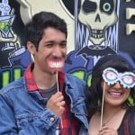 Joshua Zepeda, left, and Lorena Estrada pose in front of the Ghouls Gone Wild booth on Sunday. Photo by Tony Cagala