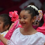 Young dancers perform ballet folklorico on stage at the Escondido Grand Avenue Festival. Photo by Tony Cagala