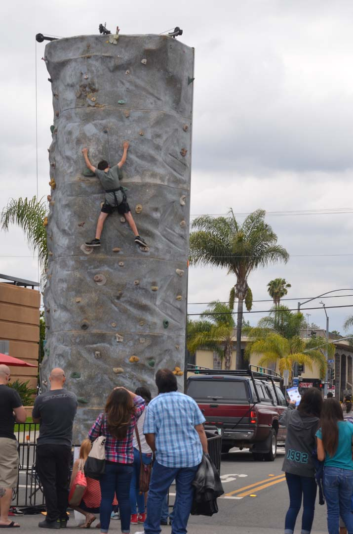 A youngster scales a climbing wall on Sunday. Photo by Tony Cagala