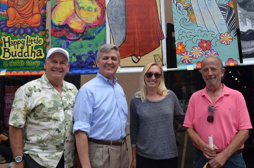 From left: Auctioneer Rich Houk, Supervisor Dave Roberts, Executive Director of Cardiff 101 Main Street Association Annika Walden and Danny Salzhandler, president of the 101 Artists' Colony before the begin of the annual Arts Alive Encinitas banner auction on Sunday. Photo by Tony Cagala