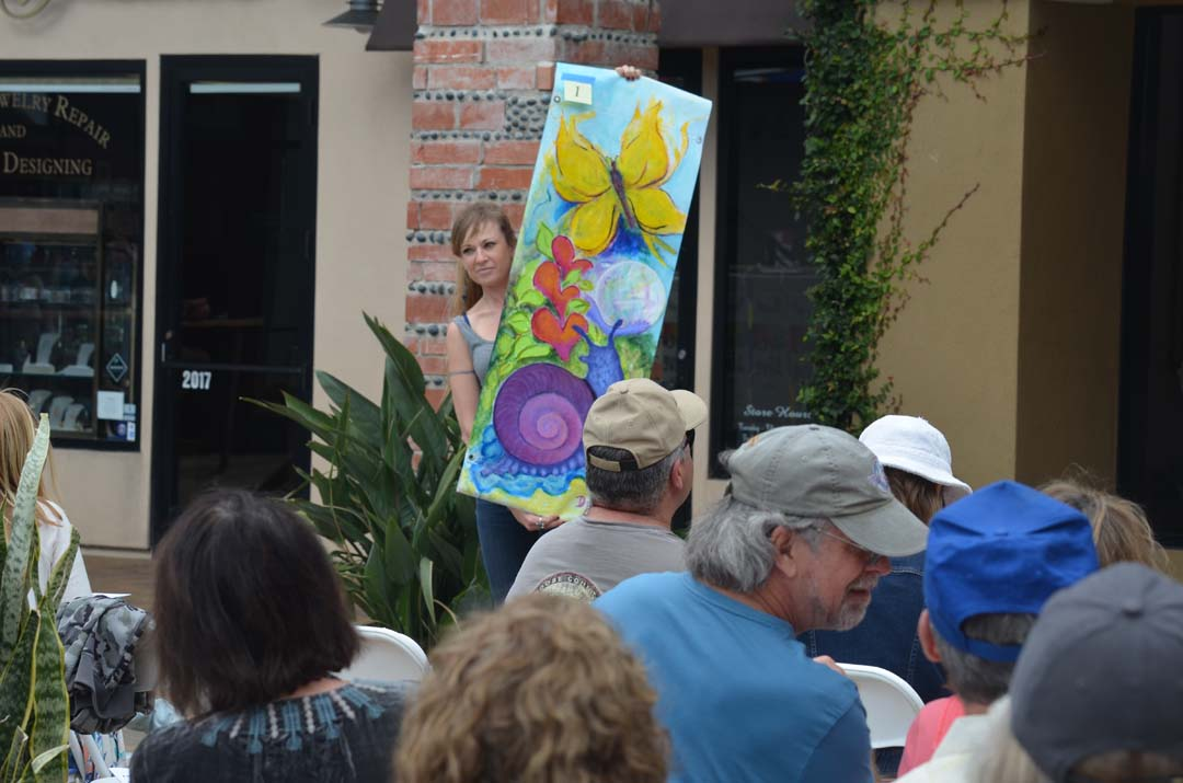 """The first banner, """"Life Outside the Shell,"""" by artist Diana Bartletti is displayed for the live auction. Photo by Tony Cagala"""