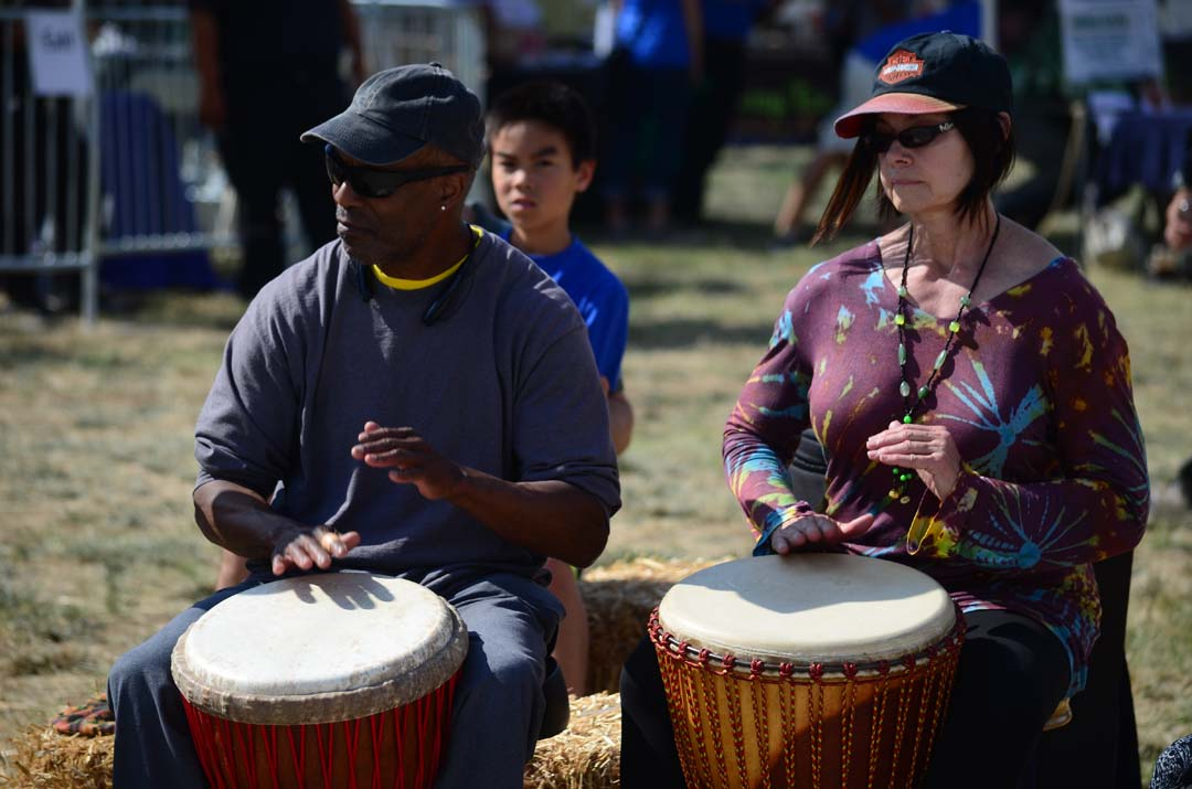 Drummers take part in a drum circle during EcoFest Encinitas. Photo by Tony Cagala
