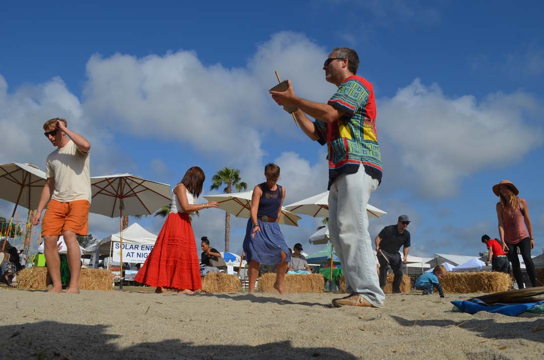 Dan Cartamil, center, leads a drum circle to close out the EcoFest Encinitas on Sunday. Photo by Tony Cagala