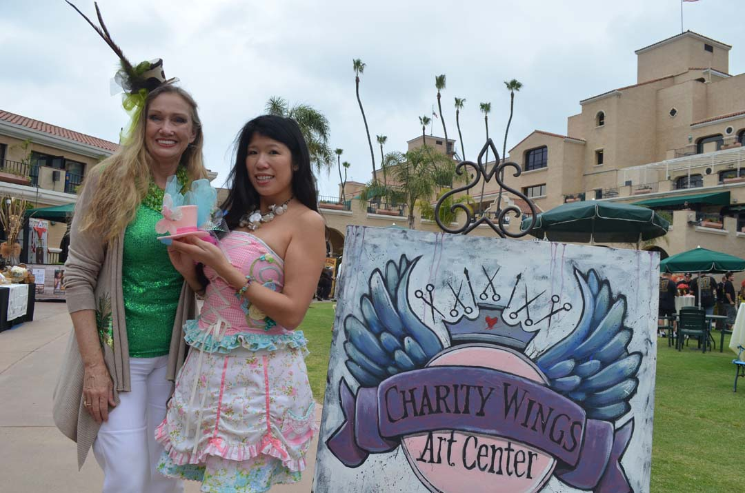 Terry Weil, left, and Elena Lai Etcheverry, founder of Charity Wings Art Center in San Marcos, creates small top hats at a San Diego County Fair preview event for media. Photo by Tony Cagala