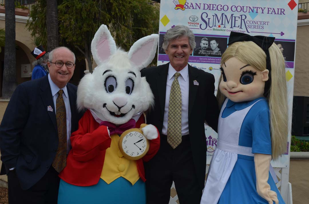 From left: Fair board President Fred Schenk, the White Rabbit, Fairgrounds General Manager Tim Fennell and Alice from Alice in Wonderland, pose for a photo. Photo by Tony Cagala