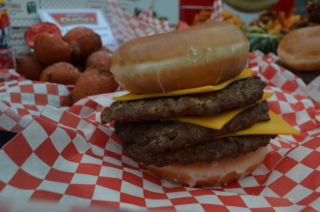 The Krispy Kreme triple-decker cheeseburger will be one of the featured menu items from Chicken Charlie's. Photo by Tony Cagala