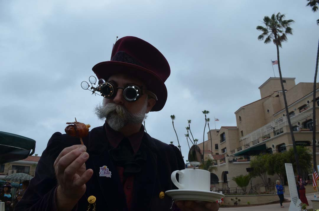 Andy Cameron, a steampunk enthusiast, tastes some bacon-wrapped French toast. Photo by Tony Cagala