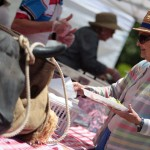 Betty Putnam of Cardiff-by-the Sea, makes her way through the BBQ line during the San Dieguito Heritage Museum's Deep Pit BBQ Celebration last Saturday afternoon. Photo by Pat Cubel