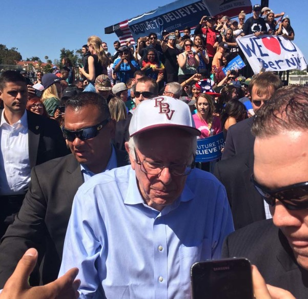 Democratic presidential candidate Bernie Sanders makes his way through a crowd of supporters after speaking in Vista on Sunday. Sanders spoke in front of about 7,400 people at Rancho Buena Vista High to rally people to vote in the California's June 7 primary. Photo by Aaron Burgin