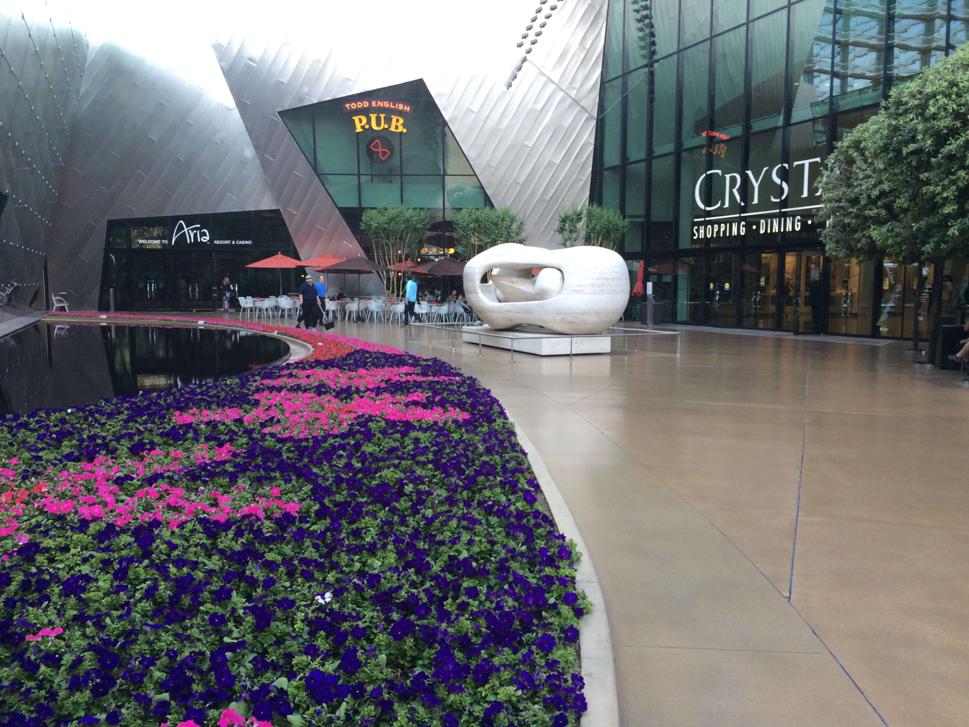 """British artist Henry Moore, who died in 1986, is said to be the most celebrated sculptor of his time. The title of this sculpture, """"Reclining Connected Forms,"""" pretty much illustrates the dominant themes of his works. This piece sits in the courtyard between Aria Resort & Casino and The Shops at Crystals. Though Moore's work made him wealthy, he lived frugally and gave most of his money to a foundation that promotes education and the arts. Photo by E'louise Ondash"""