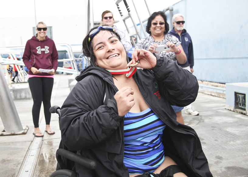 A special Olympian displays her gold medal following an aquatics event May 14 at Carlsbad High during the San Diego County's Special Olympics Regional Spring Games. Courtesy photo
