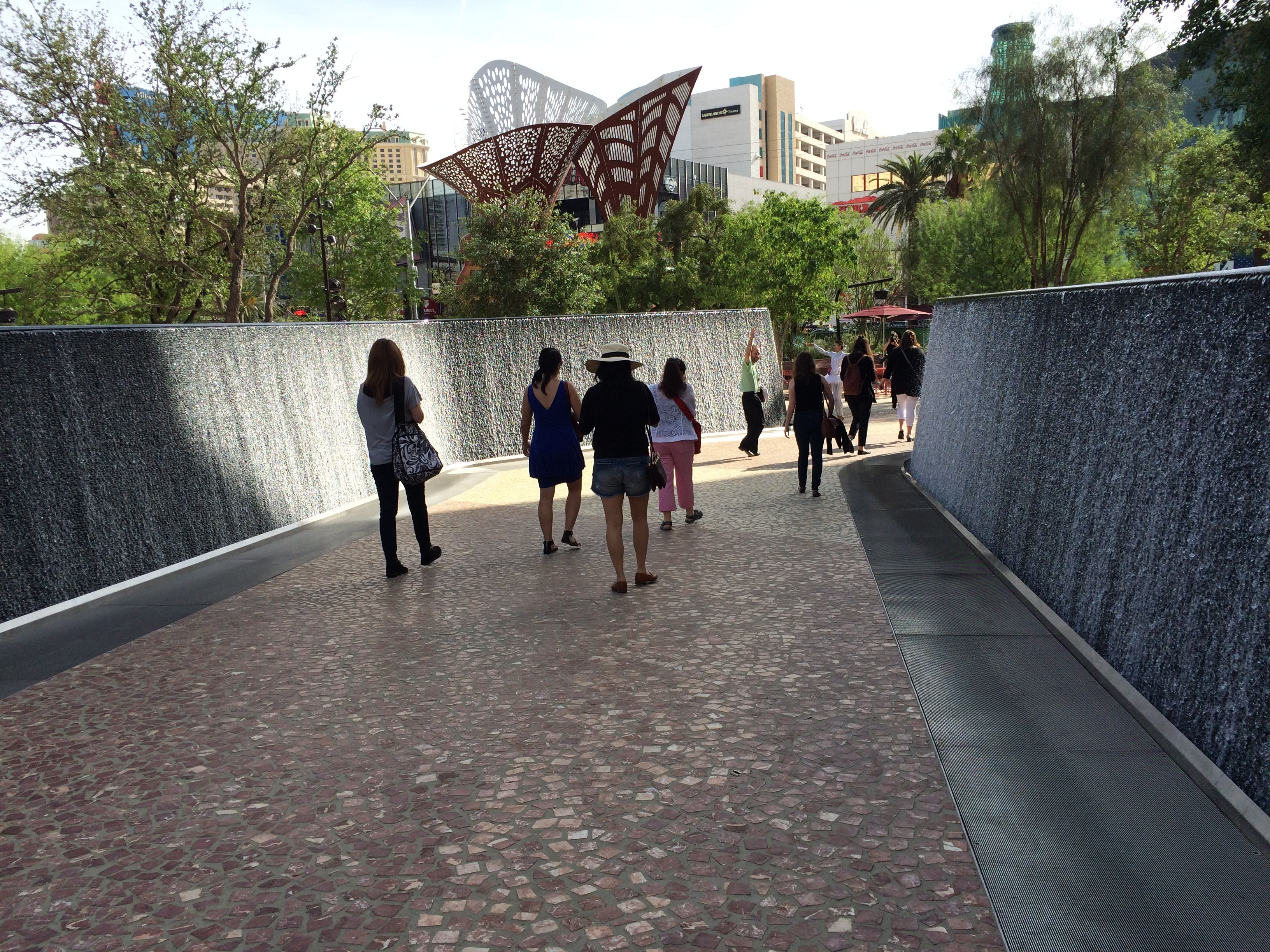 Water features like these 100-foot walls in The Park are meant to pay homage to the days when Las Vegas was a green oasis with natural bubbling springs. The flowing water creates a microclimate temperatures which can be 15 degrees to 20 degrees less than the immediate surrounding area.