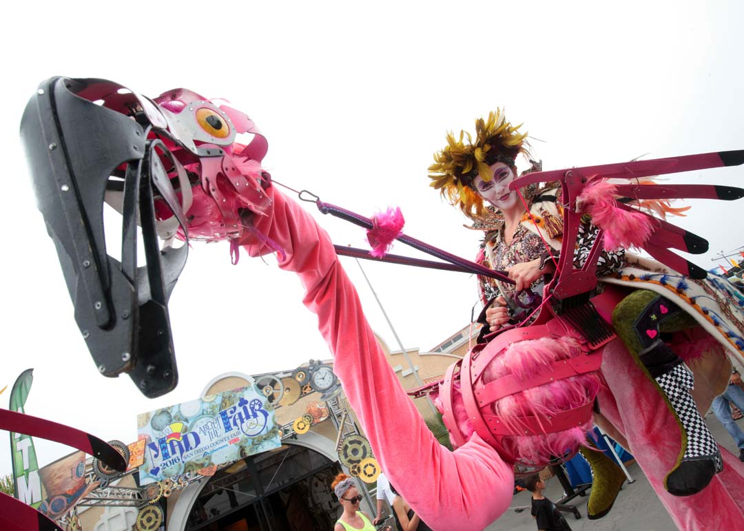 A member of the Dragon Knights walks through the crowds of fairgoers at the San Diego County Fair. Photo by Pat Cubel