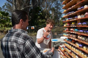 Gordon Jaefer, left, and Theodore Thompson pick out cupcakes during a fundraiser for the American Cancer Society in Escondido. Photo by Tony Cagala