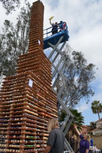 Zoe Sanchez Richardson and her son Chris measure their cupcake tower in an attempt to break the Guinness World Record for tallest cupcake tower. Photo by Tony Cagala