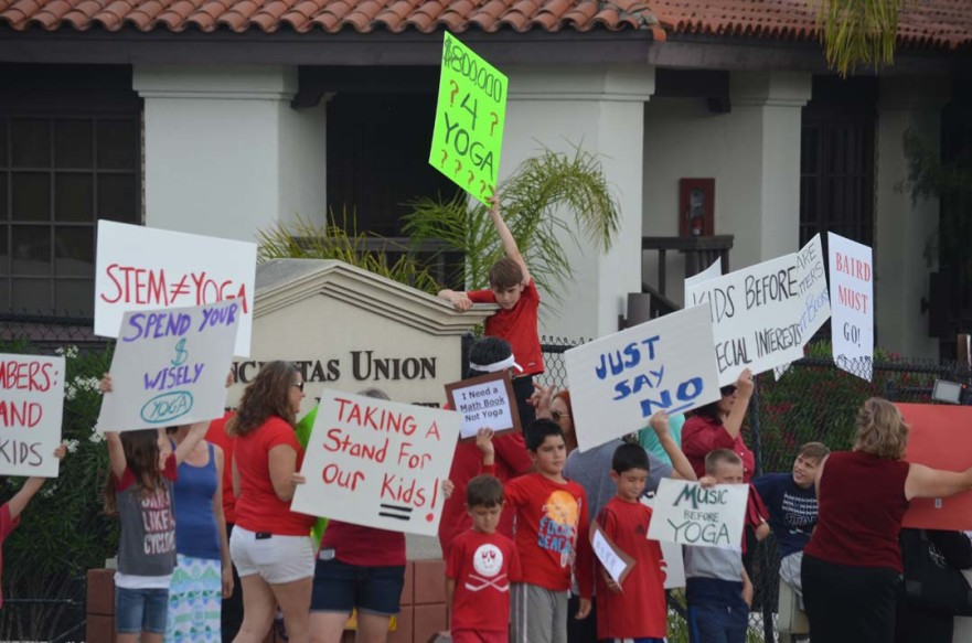 Parents and students in the Encinitas Union School District protest on Tuesday over a budget proposal to use $800,000 to keep yoga in the schools. Photo by Tony Cagala