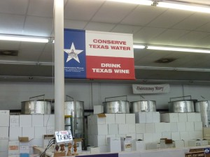 "A wine sign in the Fredericksburg Winery offers a solution for water conservation in Texas: ""Drink Texas Wine!"" Photo by Frank Mangio"