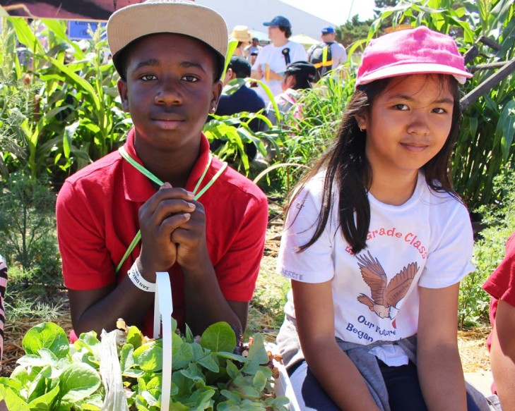 Fifth grade students Jahmari Watts and Charlene Resolme wait for their vegetables to be judged.  The Don Diego Plant, Grow, Eat program benefits students who do not have a school garden. Courtesy photo