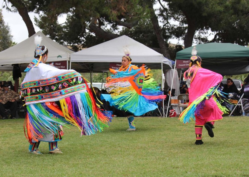 Women do the fancy shawl dance. All ages join in during the inter-tribal dance. Photo by Promise Yee