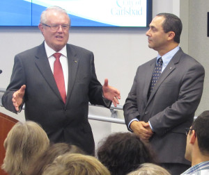 Photo by Steve Puterski Carlsbad Mayor Matt Hall, left, introduces Phil Urbina on Tuesday as Urbina was one of two residents selected as Citizen of the Year.