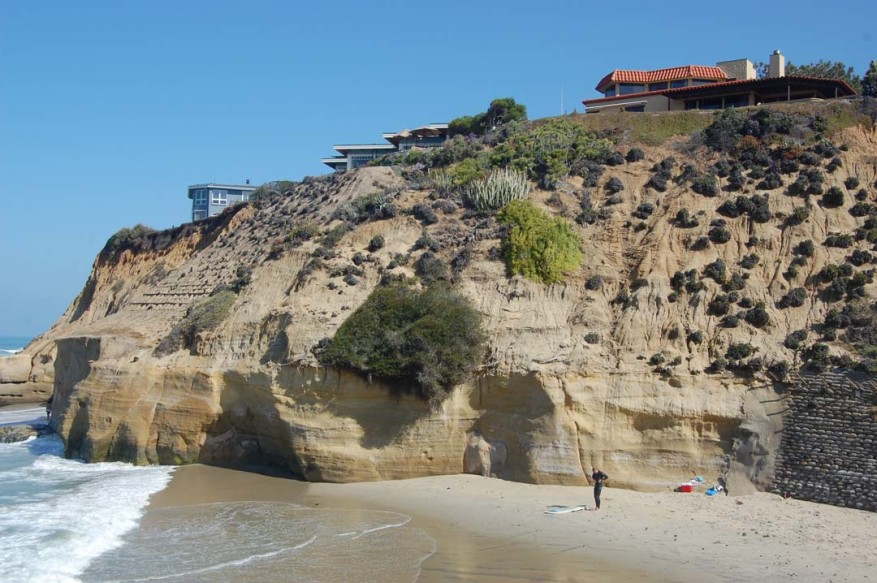 The next decision on a fee that will be paid by bluff-top property owners to compensate the public for beach that is lost by sea walls built to protect their homes was delayed for up to a year.  Photo by Bianca Kaplanek