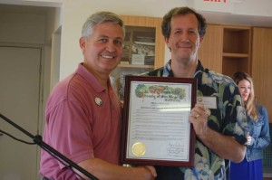 County Supervisor Dave Roberts, a Solana Beach resident and one-time mayor, presents current Mayor Dave Zito with a county proclamation.
