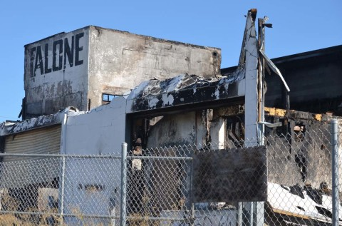 Demolition begins on building ravaged by fire