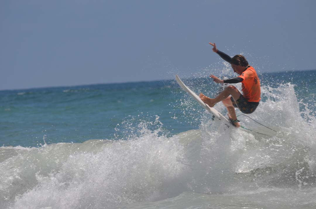Noah Slawson explodes out of some white wash. Photo by Tony Cagala