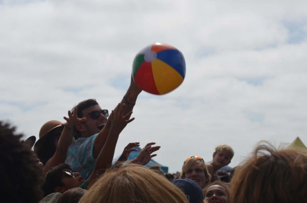 A concert-goer has fun with a beach ball before Switchfoot performed. Photo by Tony Cagala