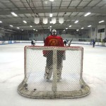 A goalie waits as players transition during a scrimmage. Photo by Tony Cagala