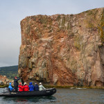 Zodiacs carry passengers from Adventure Canada's ship Ocean Endeavor to get an up close look at the huge limestone formation that sits off the coast of the Gaspe Peninsula. The rock is part of Ile Bonaventure Provincial Park and the nesting area of thousands of northern gannets.