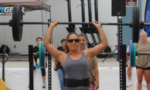 Maria Solomon completes a shoulder lift. Top women lifted 250 pound squats, 70 pound shoulders and 300 pound deadlifts. Photo by Promise Yee