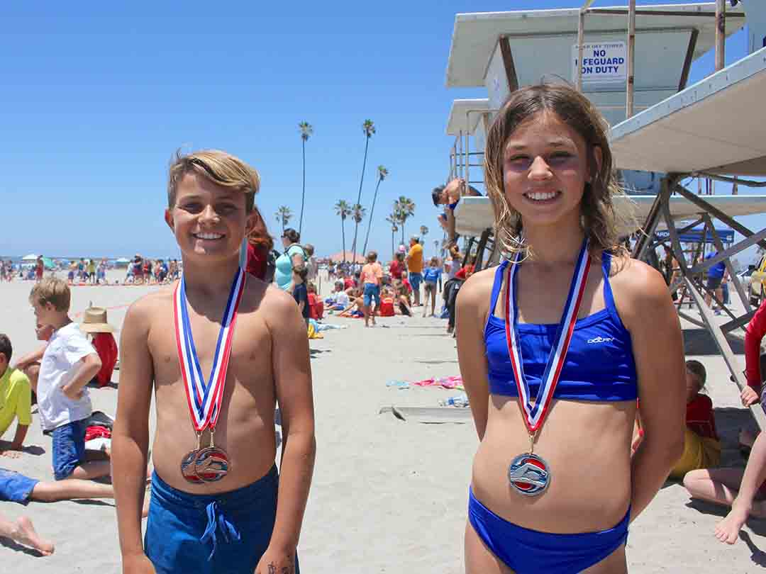 Maverick Betz, 10, and Kirra Press, 11, are both winners in the day's competitions. Close to 800 kids from Oceanside, Carlsbad, Camp Pendleton and San Clemente took part in the Junior Lifeguard Competition.