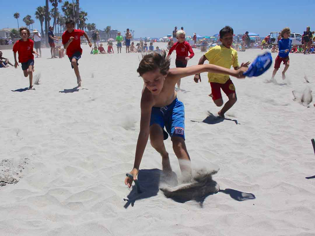 Junior Lifeguard, boys age 11 and under, compete in the  capture the flag race. The competition marks the end of the first of two Junior Lifeguard sessions.