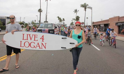 100 bicyclists ride together in Live 4 Logan parade entry