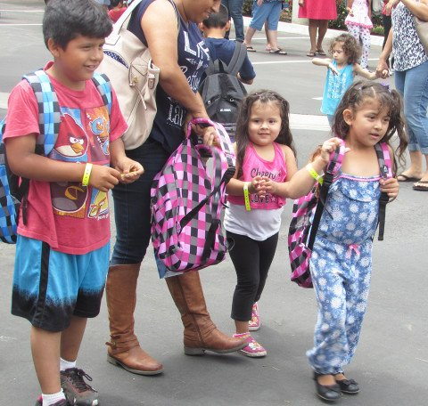 Students get treated to backbacks, books and supplies in Carlsbad
