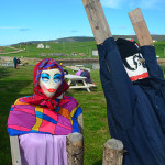 Even the fence posts are decked out in costume during Mi-Careme (which means mid-Lent), the Acadian celebration halfway through Lent that aims to provide relief from somber moods and sacrifice. These figures stand near Le Centre de la Mi-Careme, a museum in Cheticamp that works to educate others about the tradition. Mi-Careme has been celebrated in European communities since the Middle Ages, but the exact origin is unknown. (Photo by Jerry Ondash)