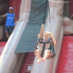 Ryan McDonald, 3, takes a ride down a zipline ride at the Vista BBQ Classic. Photo by Tony Cagala