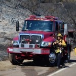 A crew from the Carlsbad Fire Department's brush company is on scene at the Gopher fire Tuesday. Photo by Tony Cagala