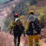Firefighters face steep, rocky terrain and brush 6 to 8-feet tall and dry grass during the Gopher fire. Photo by Tony Cagala