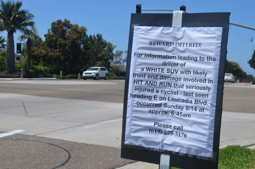 Signs asking for information in a hit-and-run accident that injured a bicyclist are posted near the accident in Encinitas. Photo by                       Tony Cagala