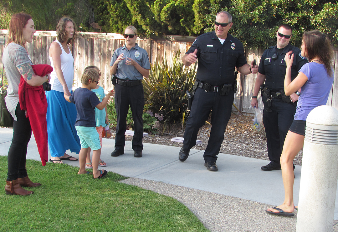 Carlsbad police officers meet residents at Hidden Canyon Community Park on Tuesday as part of National Night Out. Photo by Steve Puterski