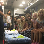 Tara Ede and, from left, Caytre Ede, Olivia DesAutels, Ella DesAutels, Mollie Shields, Ryan Harris and Kinsey Genewich on James Drive on Tuesday as part of National Night Out. Photo by Steve Puterski