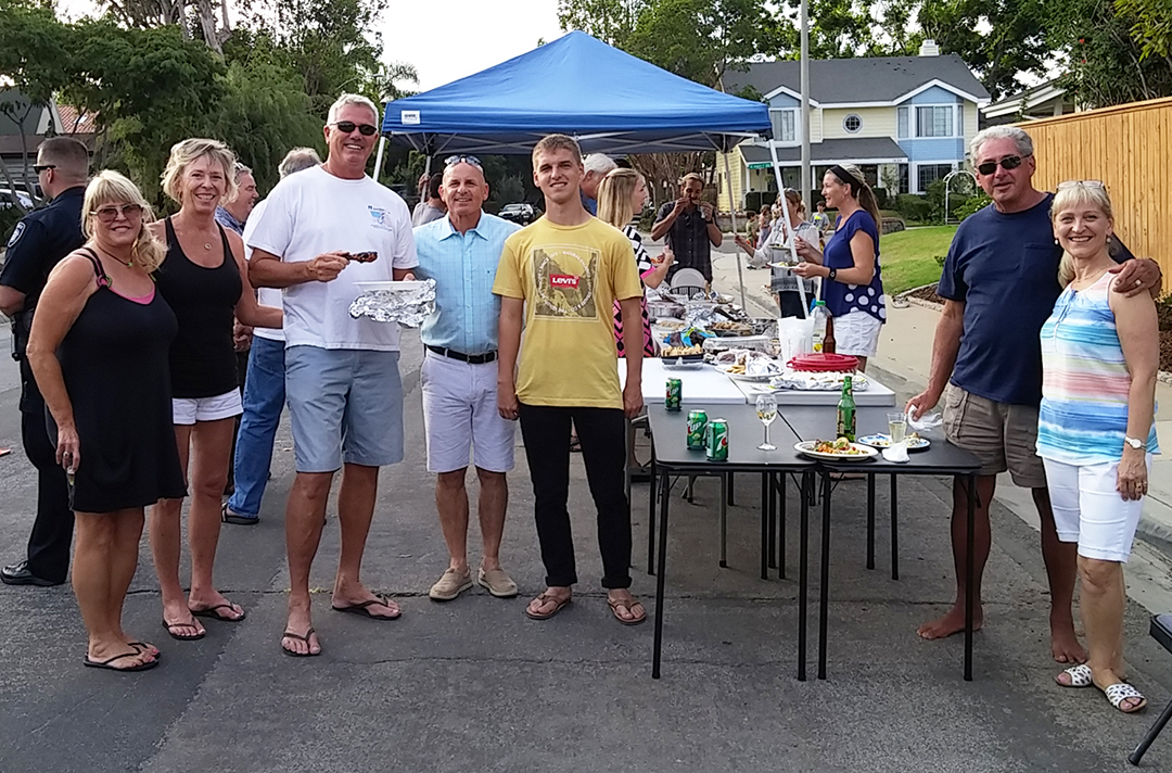 Ruth Milam, second from left, organized a block party on James Drive on Tuesday in conjunction with National Night Out. Photo by Steve Puterski