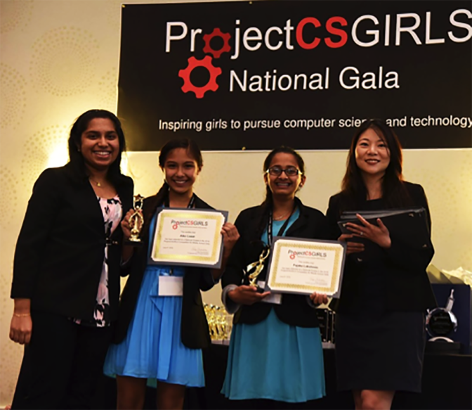AIko Lozar, second from left, and Pajaka Lakshmin, second from right, of Aviara Oaks Middle School in Carlsbad stand with Pooja Chandrashekar, left, founder and CEO of ProjectCSGIRLS, and Ting Shih, founder and Chief Executive Officer of ClickMedix, after a competition in June in Washington D.C. for ProjectCSGirls. Courtesy photo