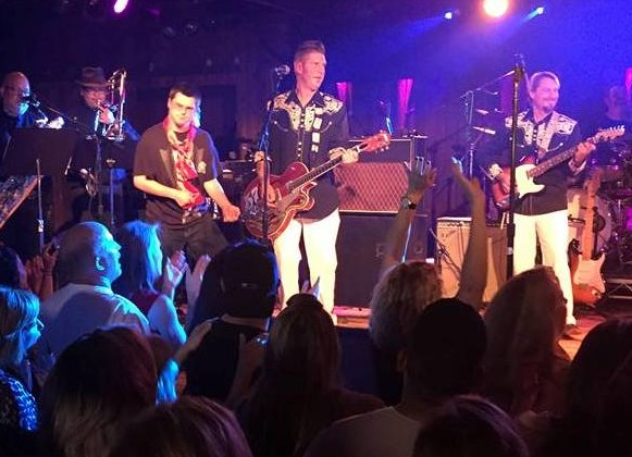 After twice being pulled onstage at Belly Up, Preston Cale, third from left, is the unofficial 13th member of Graceband, an Elvis Presley tribute ensemble.  Courtesy photo